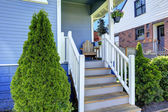 House exterior in light blue. View of entrance porch — Stockfoto