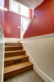 Hallway with staircase in white and red color — Stock Photo