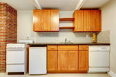 Kitchen cabinets with white appliances — Stock Photo