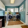 Laundry room with modern steel appliances — Stock Photo #50308843