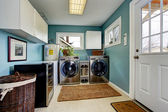 Laundry room with modern steel appliances — Stock Photo