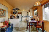 Kitchen room with dining area in old house — Stock fotografie