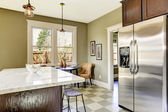 Kitchen with marble top island — Stock Photo