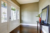 Entrance hallway with small table and mirror — Stock Photo