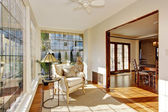 Bright sunroom with antique chair — Stock Photo
