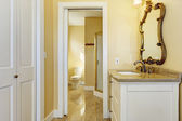 Bahtroom with washbasin cabinet and mirror — Stock Photo