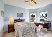 Light blue bedroom with office area — Stock Photo