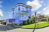 Big bright blue house with american flag — Stock Photo