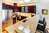 Beatufiful morern dark cabinet kitchen. — Stock Photo