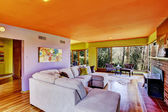 Bright cheerful living room interior — Stock Photo