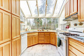 Bright kitchen room with glass wall and ceiling — Stock Photo