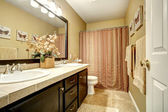 Bathroom interior with striped curtain — 图库照片
