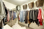 Walk-in closet with clothes — ストック写真