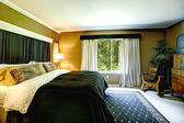Brown elegant bedroom interior with black bed and cheetah pillow — ストック写真