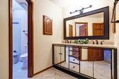 Luxury bathroom vanity cabinet in mirror trim — Foto de Stock
