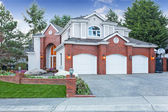 Luxury house exterior with three car garage and driveway — Stock Photo