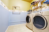 Laundry room interior in light blue and yellow colors — Stock Photo