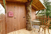 Tree house deck with entrance door — Stock Photo