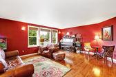 Bright red living room interior — Stock Photo