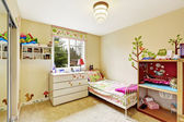 Kids room interior in soft ivory — Stock Photo