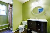 Bright green bathroom interior — Stock Photo