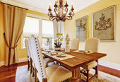 Luxury dining room with carved wood table — Stock Photo