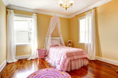 Happy girl room with pink canopy bed — Stock Photo