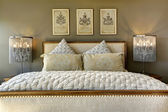 Luxury carved wood bed with pillows — Stock Photo