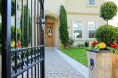 Entrance wrought iron gate to luxury house — Stock Photo