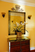 Wooden cabinet with decorative flowers and mirror — Photo