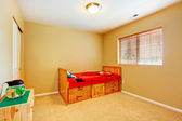 Kidss room with wooden bed — Stock Photo