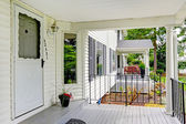 Classic white entrance porch with columns and railings — Stock Photo