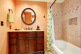 Carved wood bathroom vanity cabinet with mirror — Stock Photo