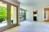 Empty house interior. Living room with door to backyard — Stock Photo