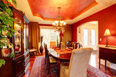 Luxury dining room in bright red colors — Stock Photo