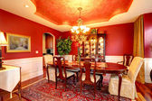 Luxury dining room in bright red color — Stock Photo