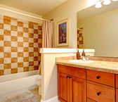 Bathroom with checker board style wall trim — Stock Photo