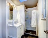 Simple bathroom interior with glass door shower — Stock Photo