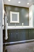 Dark bathroom vanity cabinet with white top — Stock Photo