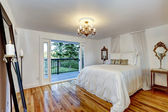 White bedroom interior with walkout deck — Стоковое фото