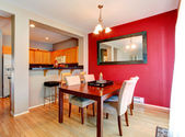 Dining room with contrast red wall — Стоковое фото