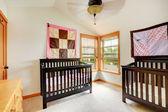 Nursery room with two cribs — Stok fotoğraf