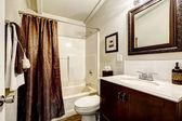 White and brown bathroom interior — Stok fotoğraf