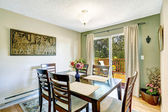 Dining room with walkout deck — Stock Photo