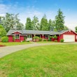 Beautiful red house with garage and curb appeal — Stock Photo #51705267