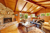 Luxury log cabin house interior. Living room with fireplace and — Stock Photo