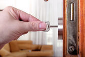 Locking or unlocking the door — Stock Photo