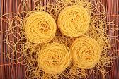 Four noodles on bamboo — Stockfoto