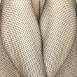 Stock Photo: Fishnet stockings