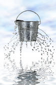 Bucket with holes — Stock Photo